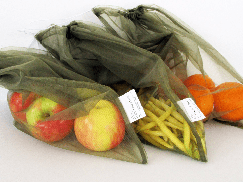 fruits and vegetables in reusable bags