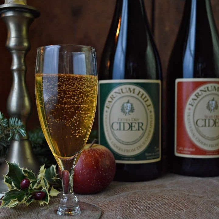 Liquor glass and bottles of cider Farnum Hill Cider Lebanon New Hampshire United States Ulocal Local Product Local Purchase