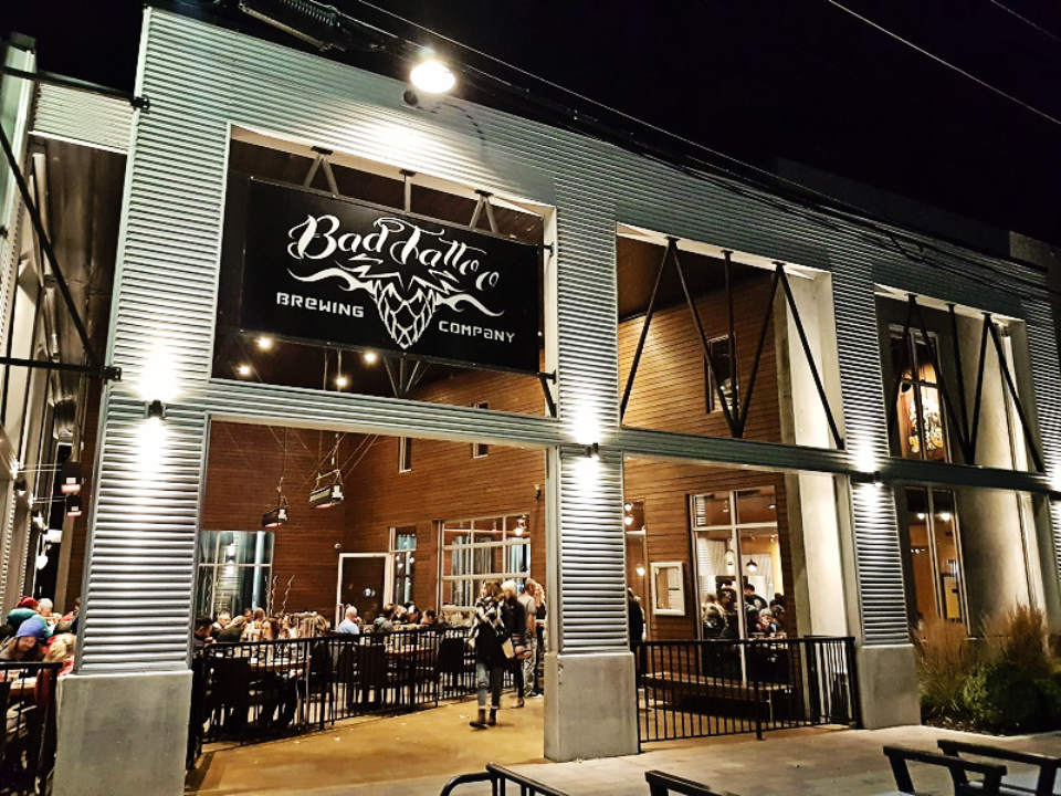 microbreweries outside view indoor terrace big doors open bad tattoo brewing penticton british columbia canada ulocal local products local purchase local produce locavore tourist
