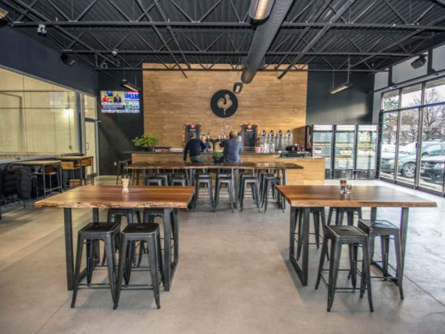 microbreweries large room with customers at the tasting bar with views of the parking and view of the manufacturing plant big rock brewery etobicoke ontario canada ulocal local products local purchase local produce locavore tourist