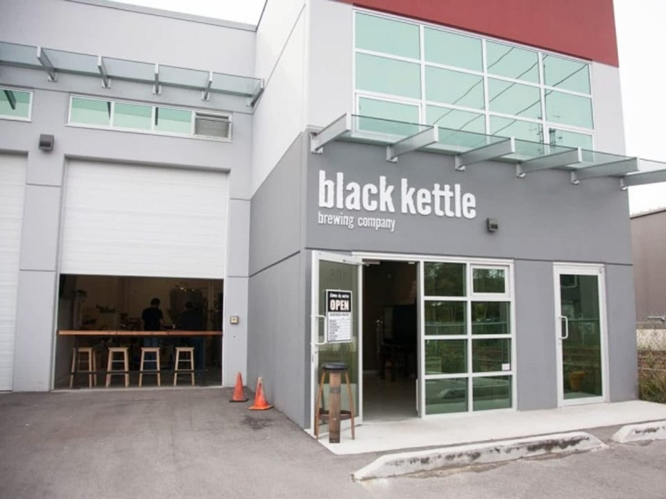 microbreweries gray building front outdoor garage door open black kettle brewing co north vancouver british columbia canada ulocal local products local purchase local produce locavore tourist