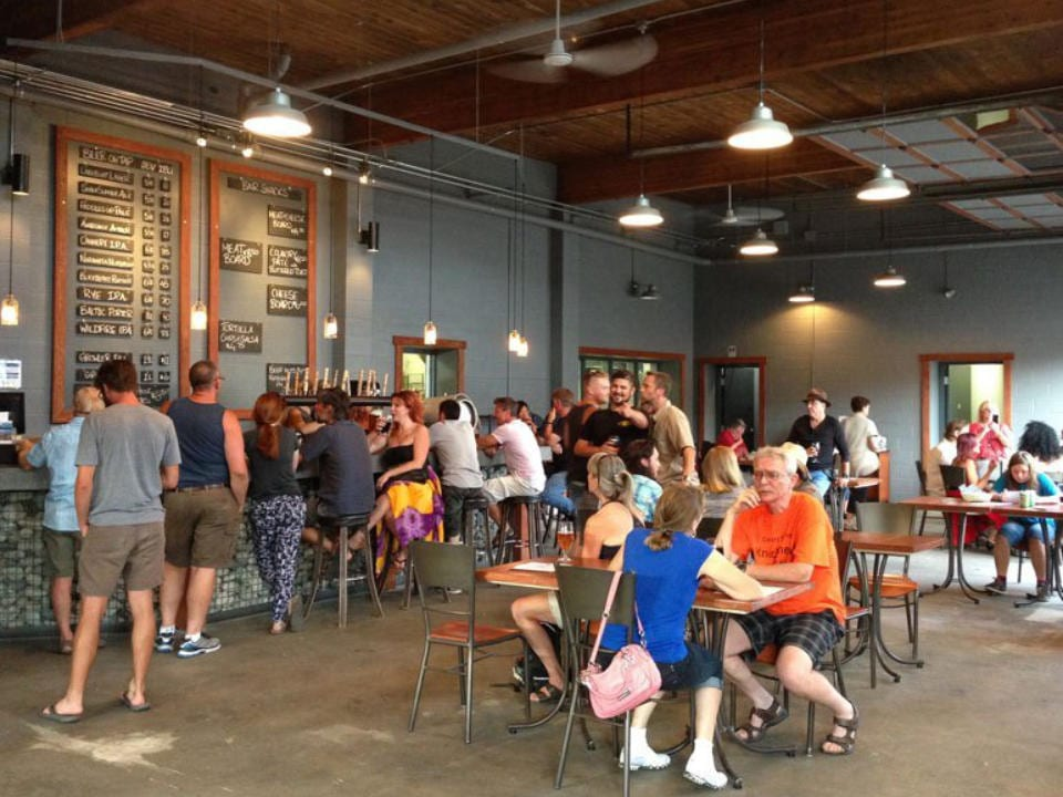 microbreweries taproom with customers having fun and craft beer cannery brewing penticton british columbia canada ulocal local products local purchase local produce locavore tourist