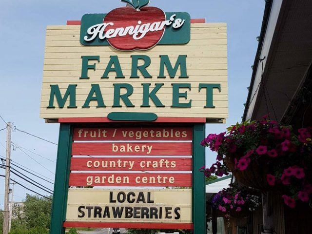 public markets outside advertising sign hennigar's farm market wolfville nova scotia canada ulocal local products local purchase local produce locavore tourist