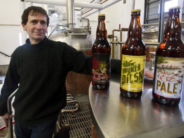 microbreweries sean hoyne owner beer on counter craft beer plant in background hoyne brewing co victoria british columbia canada ulocal local products local purchase local produce locavore tourist