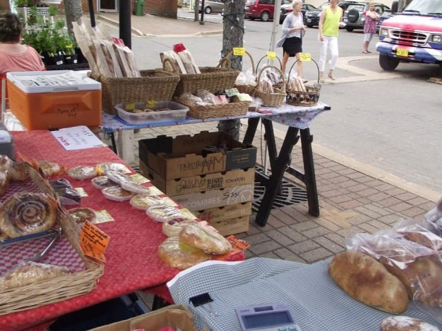 public markets outside kiosk table artisan products presentation kentville farmers market kentville nova scotia canada ulocal local products local purchase local produce locavore tourist