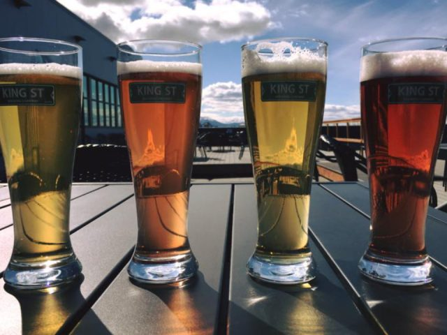 microbreweries 4 glasses of different craft beers on the rooftop terrace king street brewing co anchorage alaska united states ulocal local products local purchase local produce locavore tourist