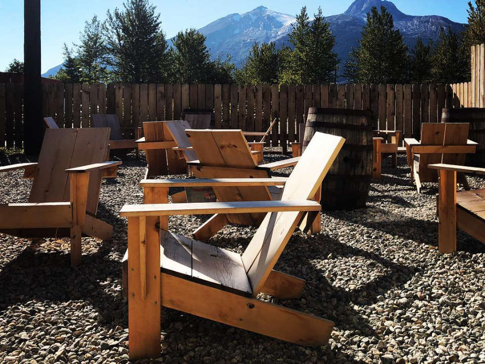 microbreweries outdoor relaxing area with patio chair on the back deck with rocky mountains views klondike brewing company skagway alaska united states ulocal local products local purchase local produce locavore tourist