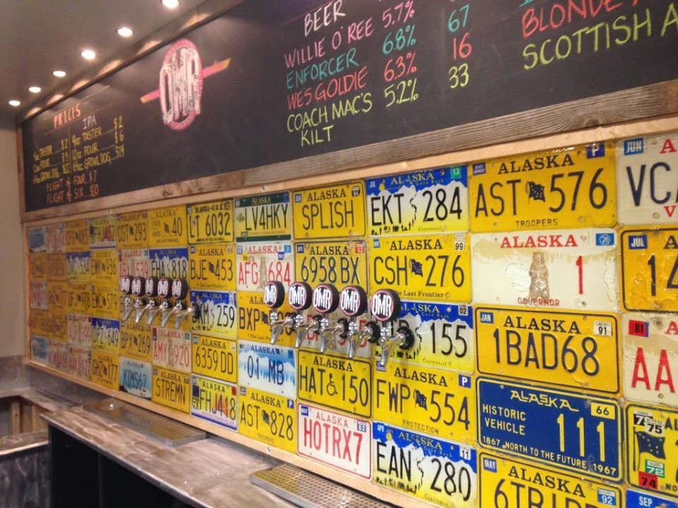 microbreweriescraft beer dispenser with 10 different options on the wall decorated with old license plates odd man rush brewing eagle river alaska united states ulocal local products local purchase local produce locavore tourist