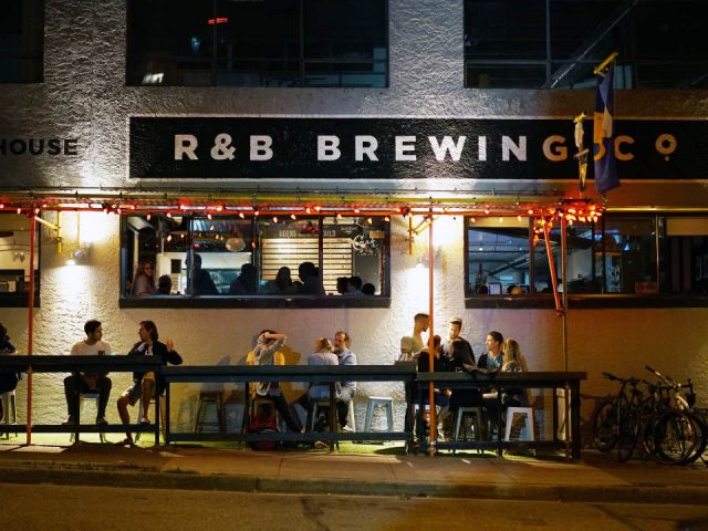 microbreweries oudoor front patio at night with customers randb brewing vancouver british columbia canada ulocal local products local purchase local produce locavore tourist