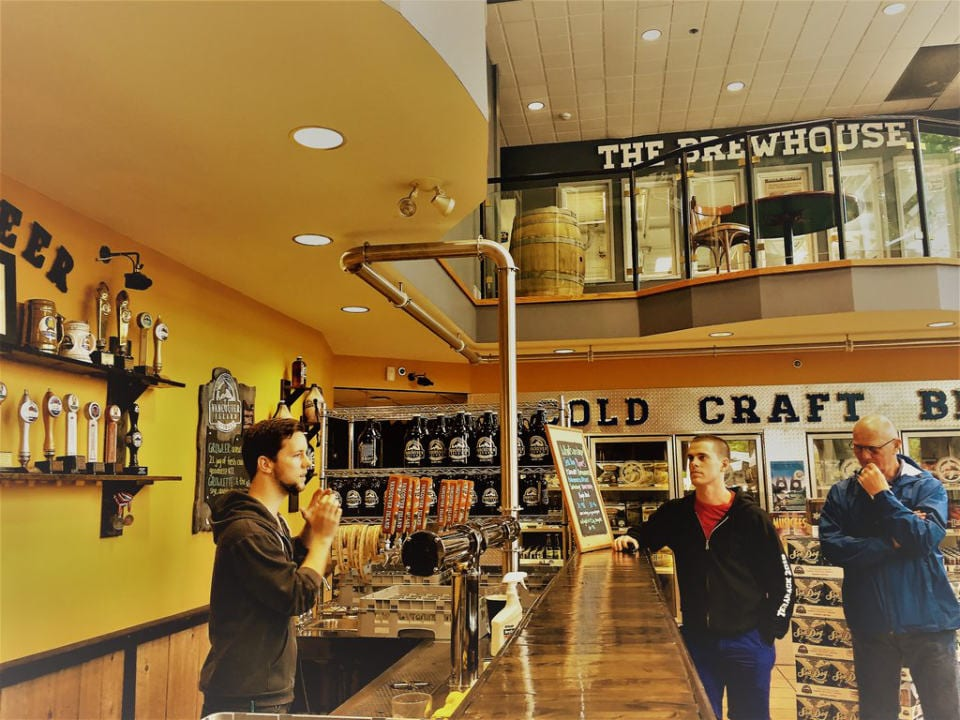 microbreweries two floors store tasting bar host customers beer fridge vancouver island brewing victoria british columbia canada ulocal local products local purchase local produce locavore tourist