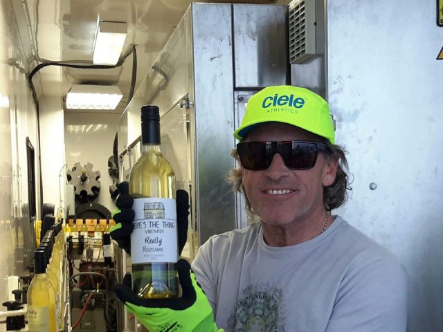 vineyard man who is bottling the wine with the manufacturing plant backheres the thing vineyards oliver british colombia canada ulocal local products local purchase local produce locavore tourist