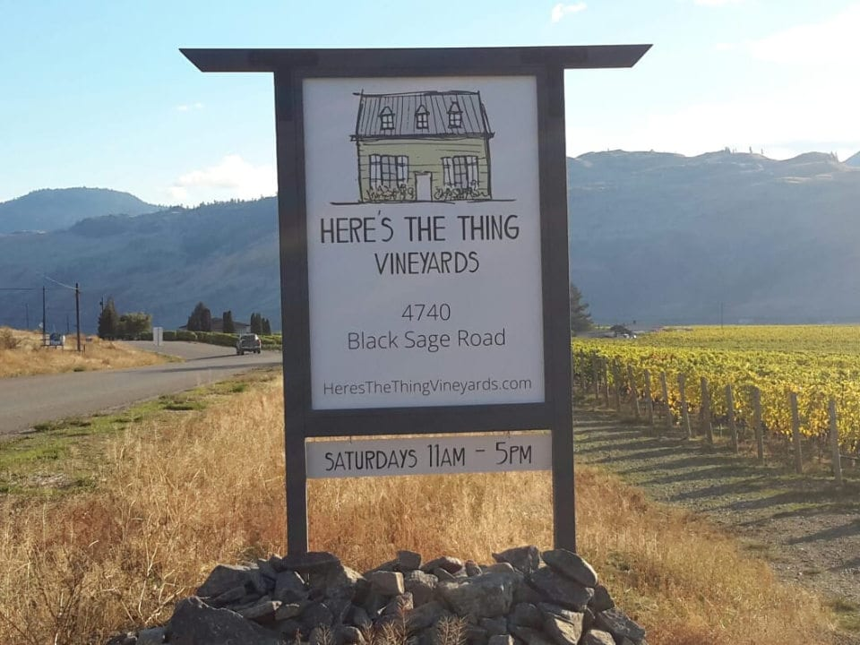 vineyard vineyard sign on the side of the road with the vineyard in the background heres the thing vineyards oliver british colombia canada ulocal local products local purchase local produce locavore tourist