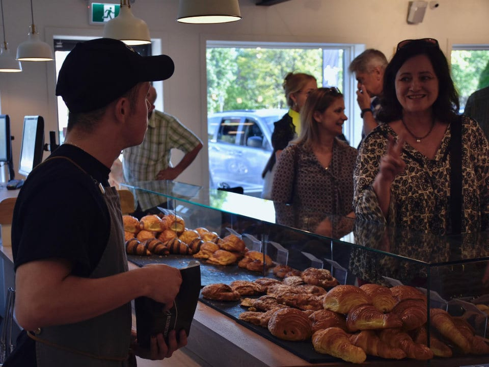 artisan bakeries several customers in front of the pastry and bread counters ordering employees in service l'amour du pain boucherville boucherville quebec canada ulocal local products local purchase local produce locavore tourist