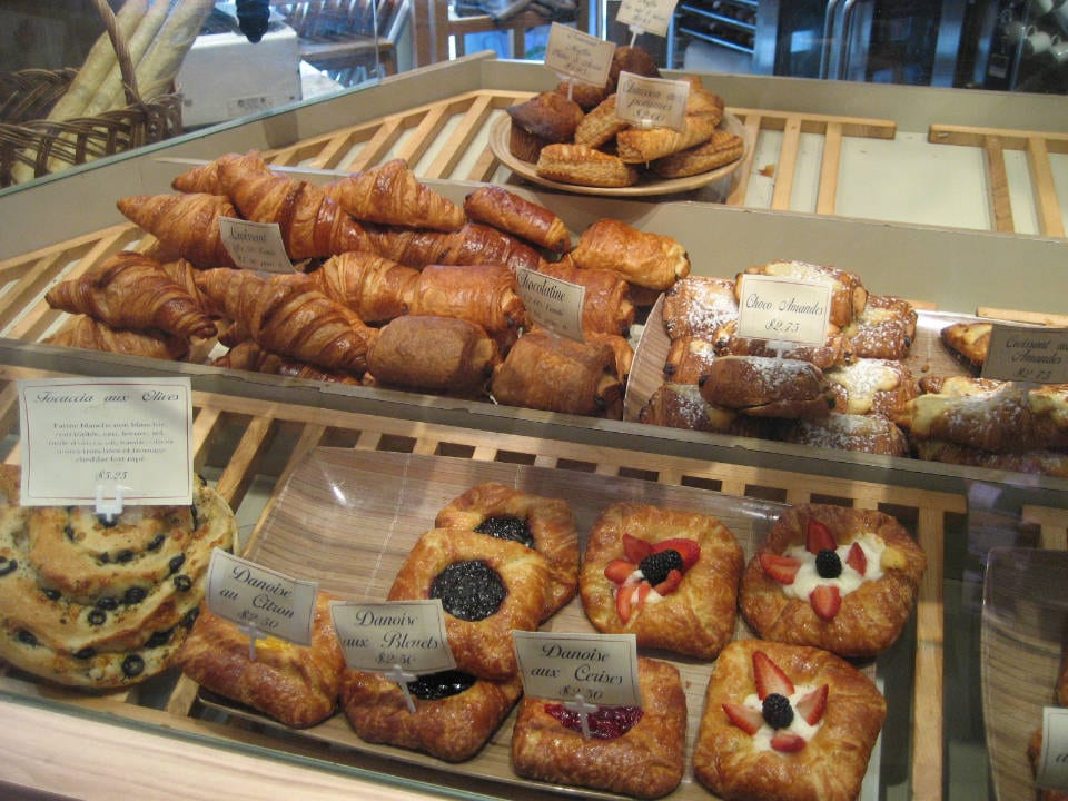 artisan bakeries display of chocolate croissants pastries brioche breads of the day au pain doré de l'avenir laval quebec canada ulocal local products local purchase local produce locavore tourist