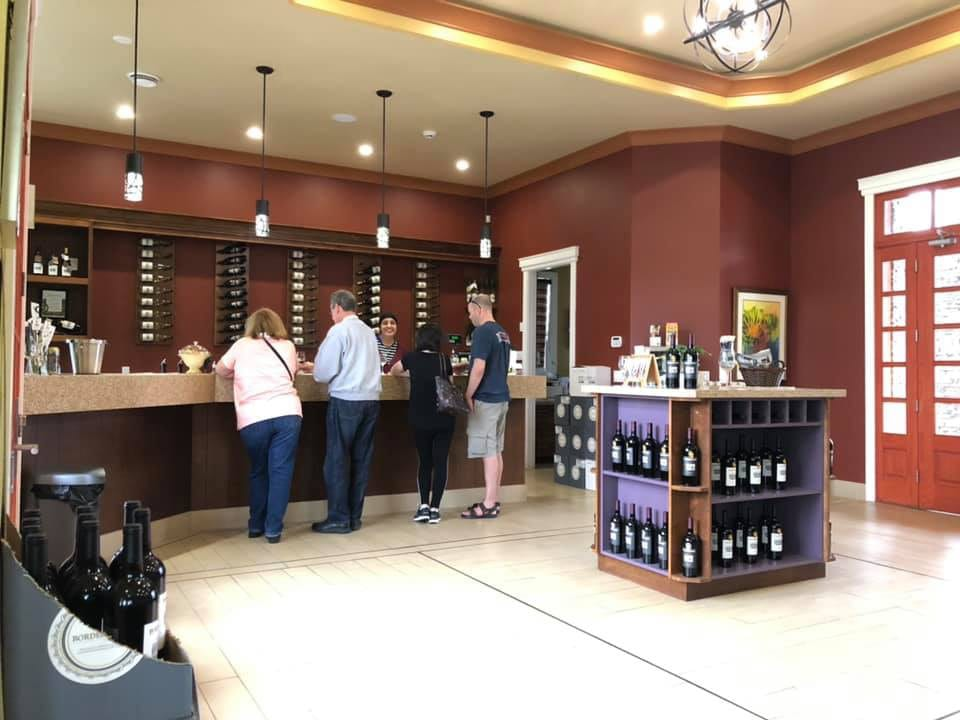 vineyard large tasting room with bar staff and guestsbordertown vineyards and estate winery osoyoos british colombia canada ulocal local products local purchase local produce locavore tourist