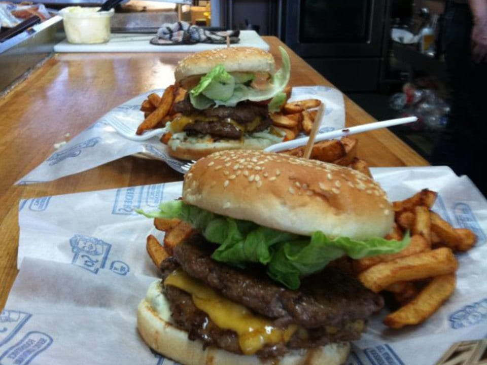 restaurant hamburger cheese salad and french fries on the service counter burger bob hemmingford quebec canada ulocal local products local purchase local produce locavore tourist