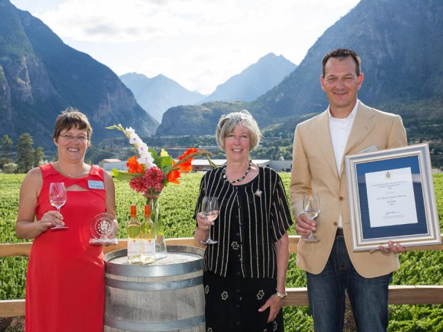 vineyard owners receive a prestigious award on a terrace with vineyard in the background fort berens estate winery lillooet british colombia canada ulocal local products local purchase local produce locavore tourist