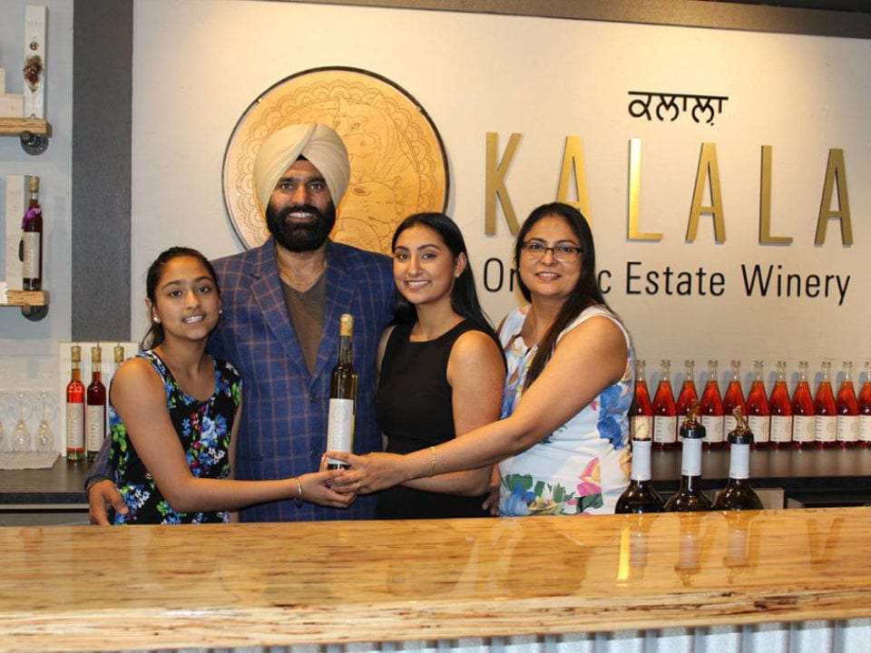 vineyard winemaker and his family at the tasting bar kalala organic estate winery west kelowna british colombia canada ulocal local products local purchase local produce locavore tourist
