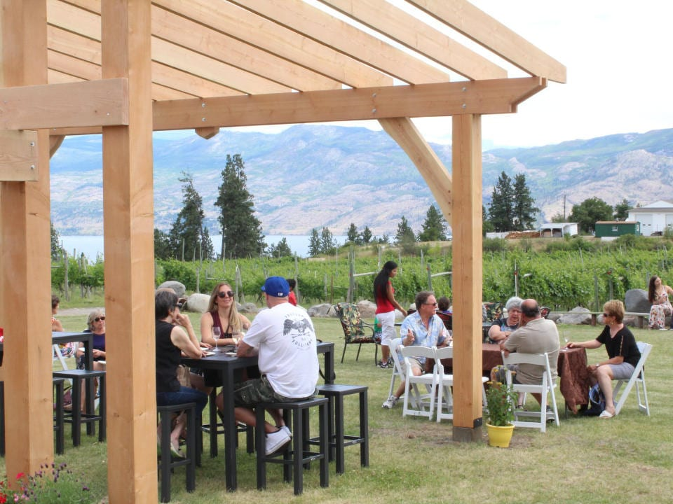 vineyard land next to the vineyard where people can enjoy their wine sitting at the tables and enjoy a magnificent scenery kalala organic estate winery west kelowna british colombia canada ulocal local products local purchase local produce locavore tourist