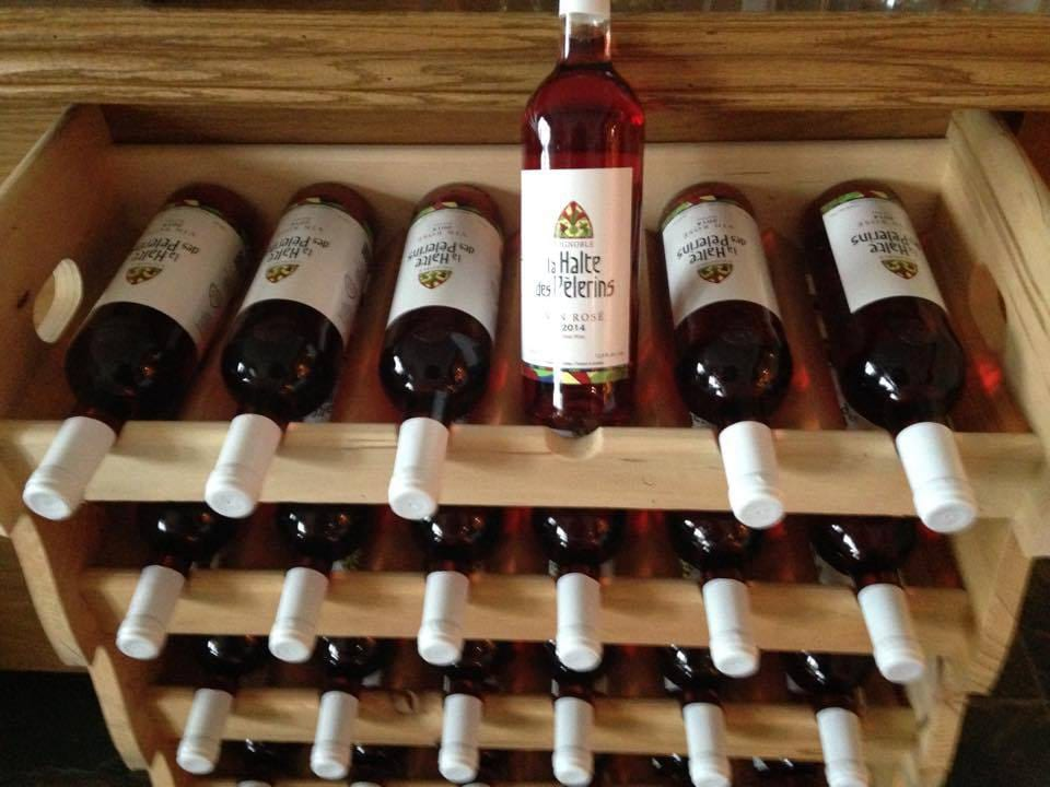 vineyard bottles of rosé wines on a wooden rack la halte des pèlerins sherbrooke quebec canada ulocal local products local purchase local produce locavore tourist