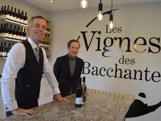 Vineyard winemaker sebastien daoust behind the tasting counter ready to welcome customers les vignes des bacchantes hemmingford quebec canada ulocal local products local purchase local produce locavore tourist