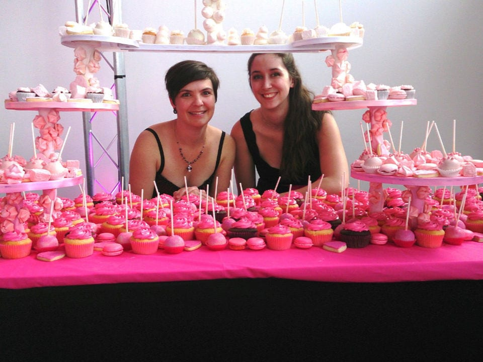 pastry shops owner manon houle and pastry mylène papillon-mathieu who present a table of pink and white cupcakes desserts pâtisserie la vitrine sherbrooke quebec canada ulocal local products local purchase local produce locavore tourist