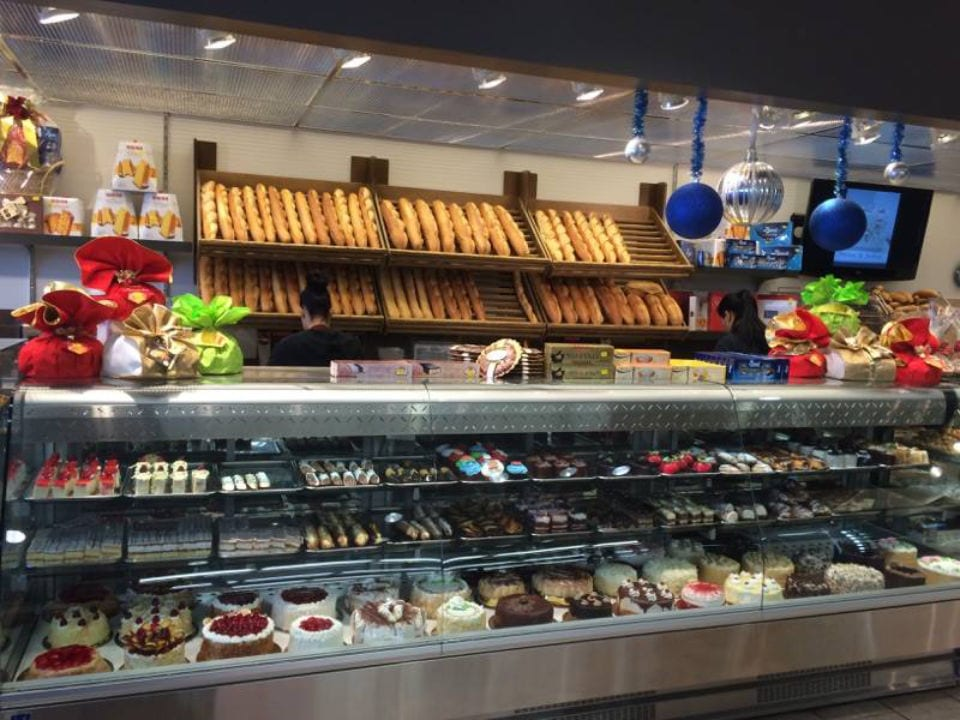 pastry shops refrigerated display of pastries and cakes with baked goods on the wall pâtisserie lasalle lasalle quebec canada ulocal local products local purchase local produce locavore tourist