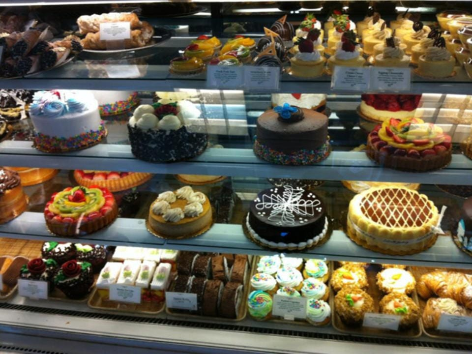 pastry shops refrigerated display of pastries and cakes pâtisserie lasalle lasalle quebec canada ulocal local products local purchase local produce locavore tourist