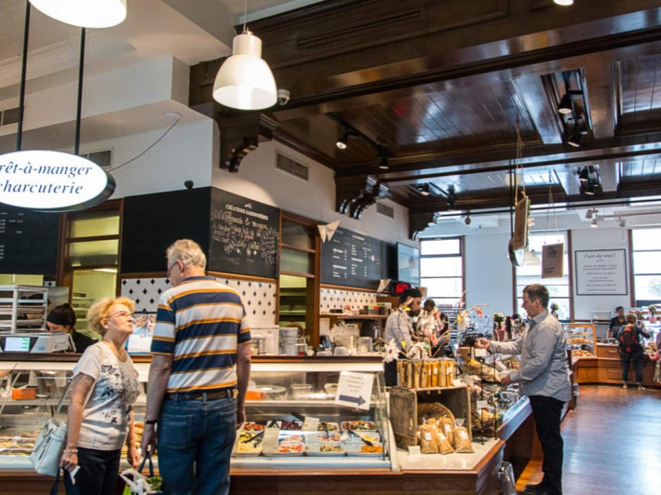 artisan bakeries interior of the shop several customers in front of the ready-to-eat counters of the bakeries and the cash desk première moisson dix30 brossard quebec canada ulocal local products local purchase local produce locavore tourist