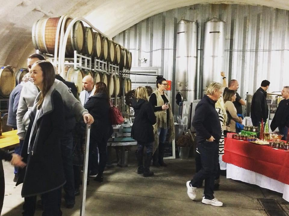 vineyard guests who taste wines directly in the wine cellar in a hangarrollingdale winery west kelowna british colombia canada ulocal local products local purchase local produce locavore tourist