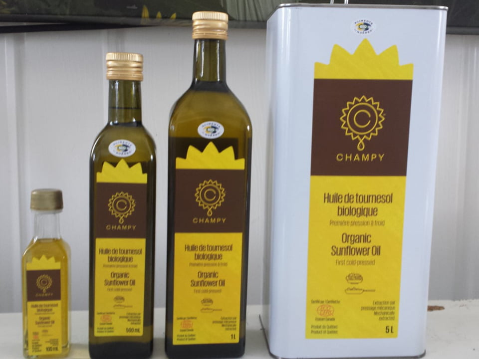 food 3 bottles and a container of 5 liters of organic sunflower oil first cold pressed les huiles champy upton quebec canada ulocal local products local purchase local produce locavore tourist
