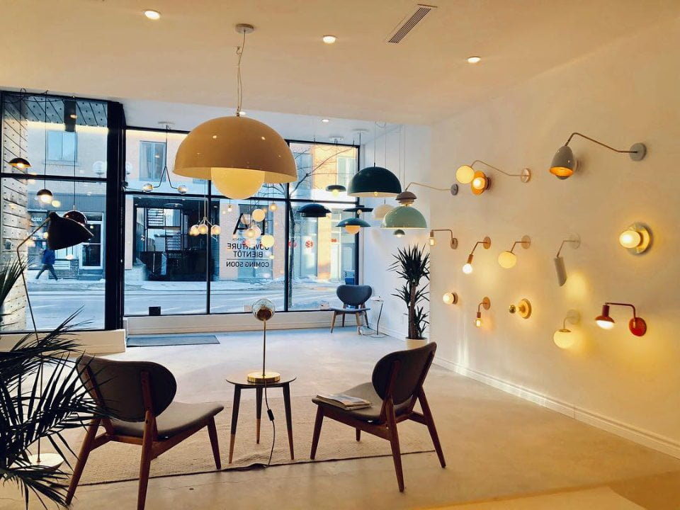 Interior decoration showroom with light fixtures on the walls and ceiling and view of the glazed facade of the shop luminaire authentik montreal quebec canada ulocal local products local purchase local produce locavore tourist