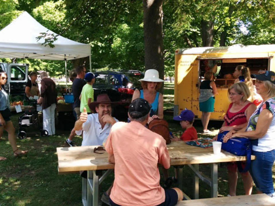 public markets people sitting at picnic tables specially installed next to the food truck bayfield farmers market bayfield ontario canada ulocal local products local purchase local produce locavore tourist