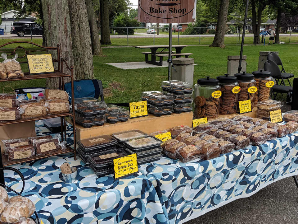 public markets outdoor kiosk of homemade products pastries and cookies belle river farmers market belle river ontario canada ulocal local products local purchase local produce locavore tourist