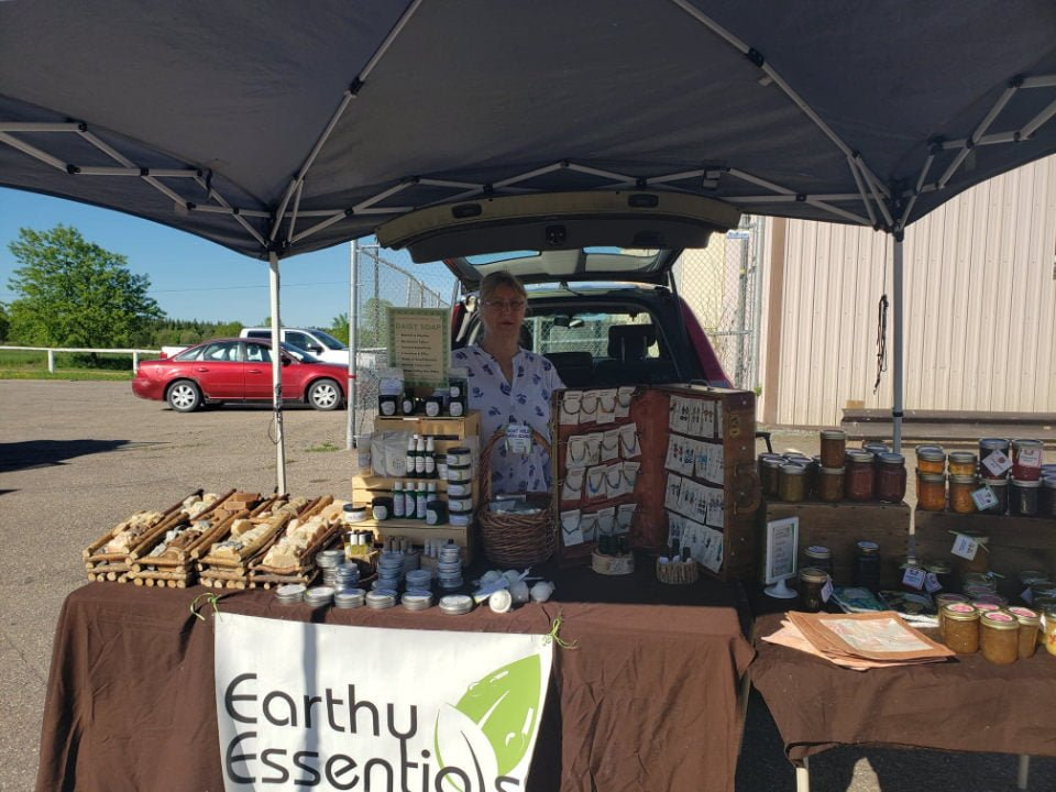 public markets kiosk of nancy rantz of erthy essentials cobden farmers market cobden ontario canada ulocal local products local purchase local produce locavore tourist