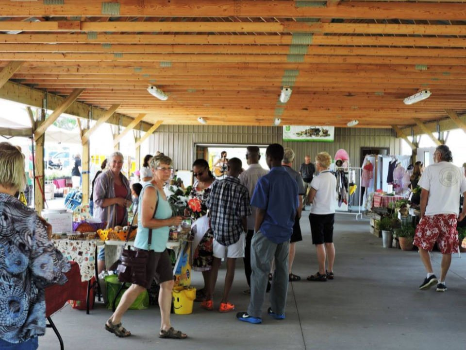 public markets covered market with people visiting kiosks codrington farmers market codrington ontario canada ulocal local products local purchase local produce locavore tourist