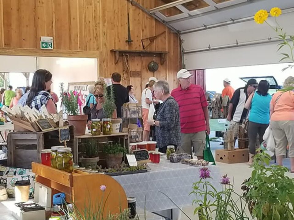 public markets indoor kiosks with customers on the site dunnville farmers market dunnville ontario canada ulocal local products local purchase local produce locavore tourist