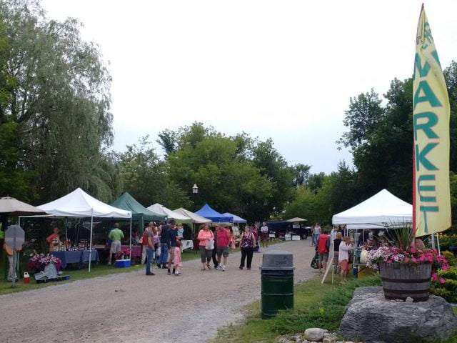 public markets outdoor market with people on the site and kiosks of local products kinmount farmers market kinmount ontario canada ulocal local products local purchase local produce locavore tourist