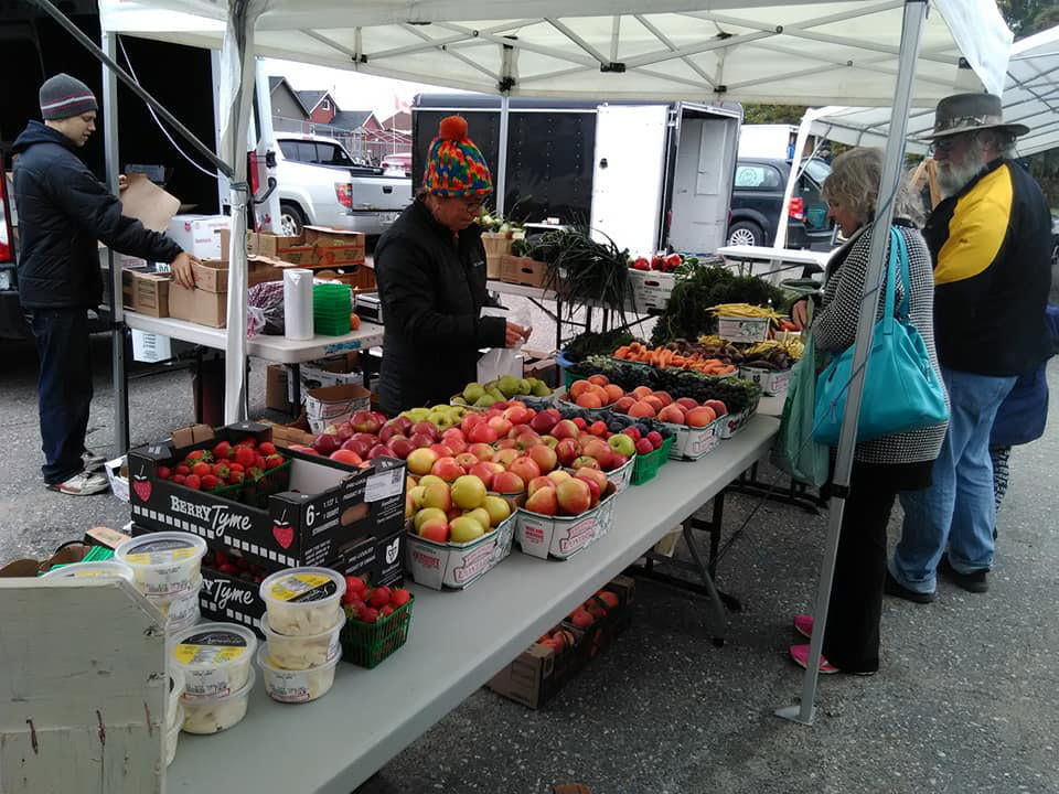 public markets boots of fruits and vegetables with customers mountjoy farmers market timmins ontario canada ulocal local products local purchase local produce locavore tourist