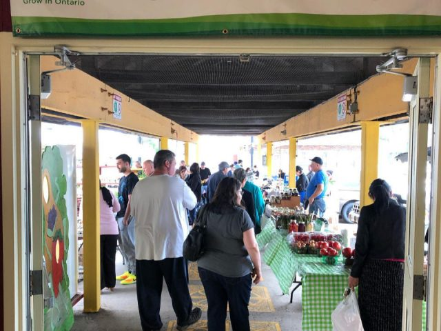 public markets covered outdoor kiosks with people at boots niagara falls farmers market niagara falls ontario canada ulocal local products local purchase local produce locavore tourist