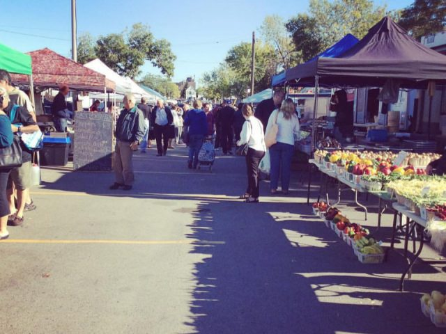 public markets outdoor market with customers on the site on a sunny day ottawa street farmers market hamilton ontario canada ulocal local products local purchase local produce locavore tourist