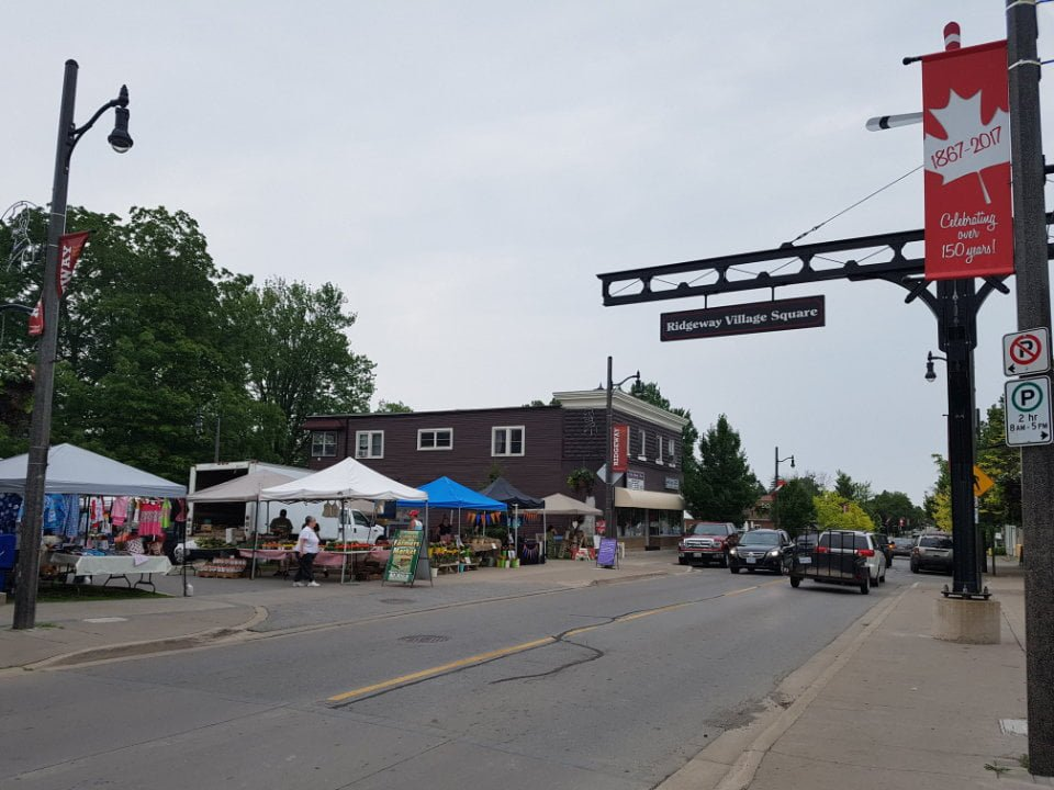 public markets outdoor market on the roadside with people in kiosks on a cloudy day ridgeway farmers market ridgeway ontario canada ulocal local products local purchase local produce locavore tourist