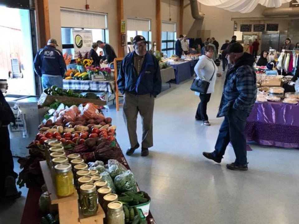 public markets indoor market with people walking around kiosks riverside farmers market new liskeard ontario canada ulocal local products local purchase local produce locavore tourist