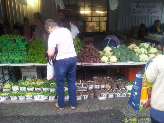 public markets fresh vegetable kiosk with a customer sarnia farmers market sarnia ontario canada ulocal local products local purchase local produce locavore tourist