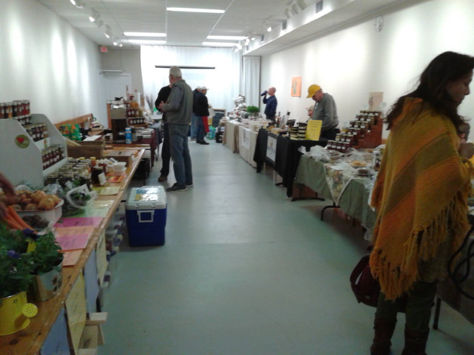 public markets winter indoor market with people walking around kiosks southern georgian bay farmers markets midland winter market midland ontario canada ulocal local products local purchase local produce locavore tourist