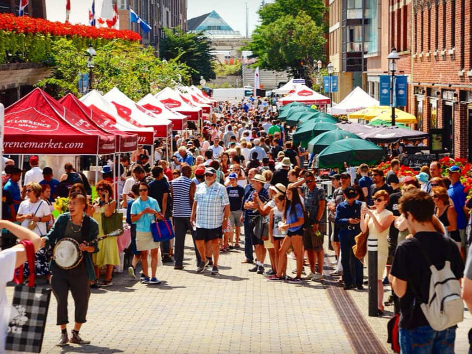 public markets outdoor market crowded with people during a beautiful sunny day st lawrence farmers market toronto ontario canada ulocal local products local purchase local produce locavore tourist