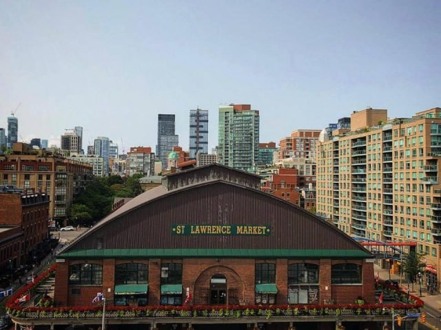 public markets exterior brown brick market building with top view of the city of toronto and its buildings st lawrence farmers market toronto ontario canada ulocal local products local purchase local produce locavore tourist