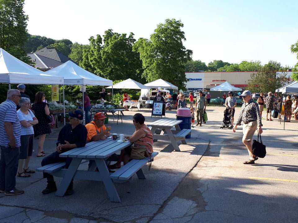 public markets sunny day at the market with many visitors to the site with picnic tables in the middle st marys farmers market saint marys ontario canada ulocal local products local purchase local produce locavore tourist