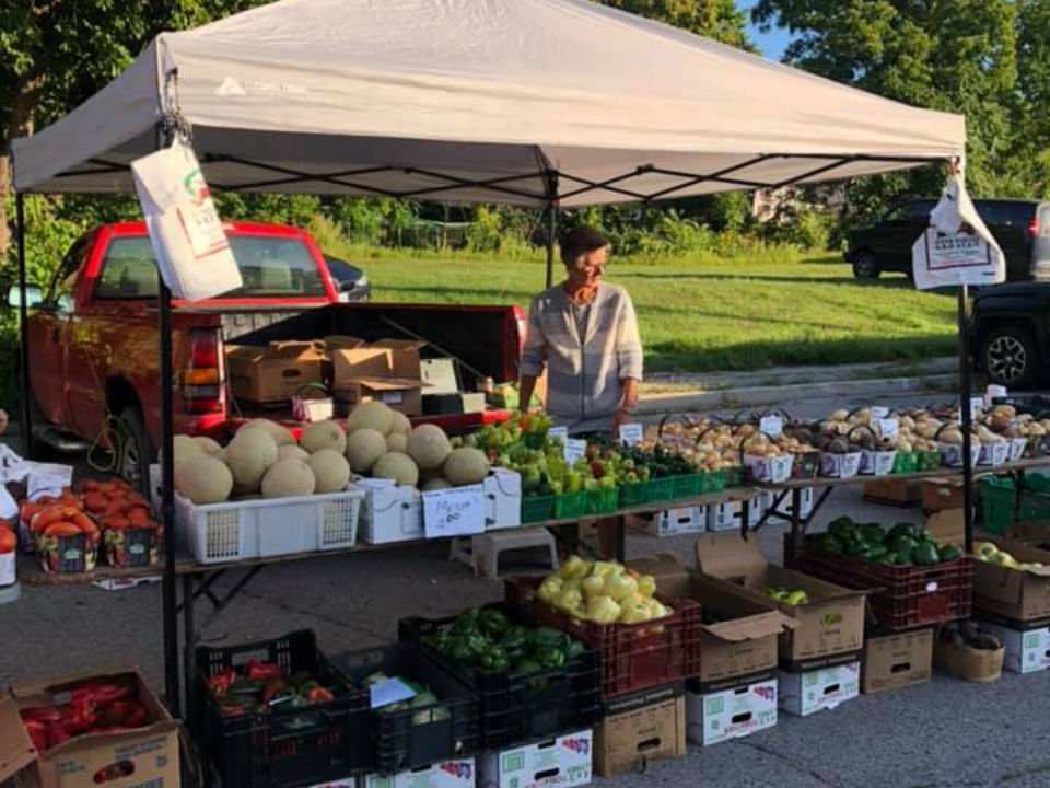public markets table of fruits and vegetables with her representative tillsonburg farmers market tillsonburg ontario canada ulocal local products local purchase local produce locavore tourist