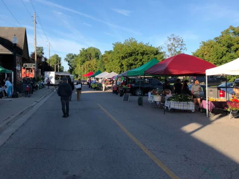 public markets outdoor market in the street with people at kiosks tillsonburg farmers market tillsonburg ontario canada ulocal local products local purchase local produce locavore tourist